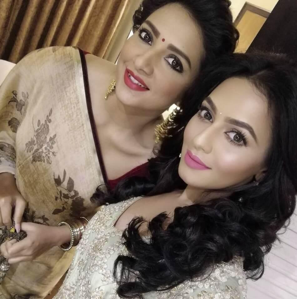Bangladeshi actress Nusrat Faria Mazhar with co actress