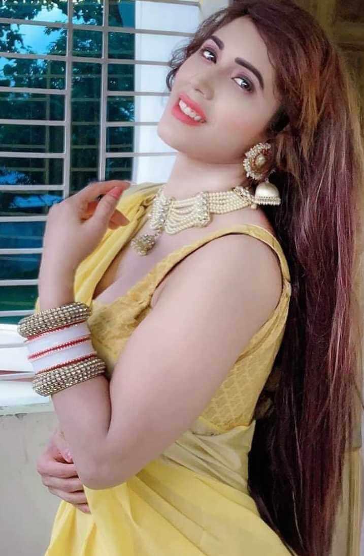 Naila Nayem Yellow Saree Photo