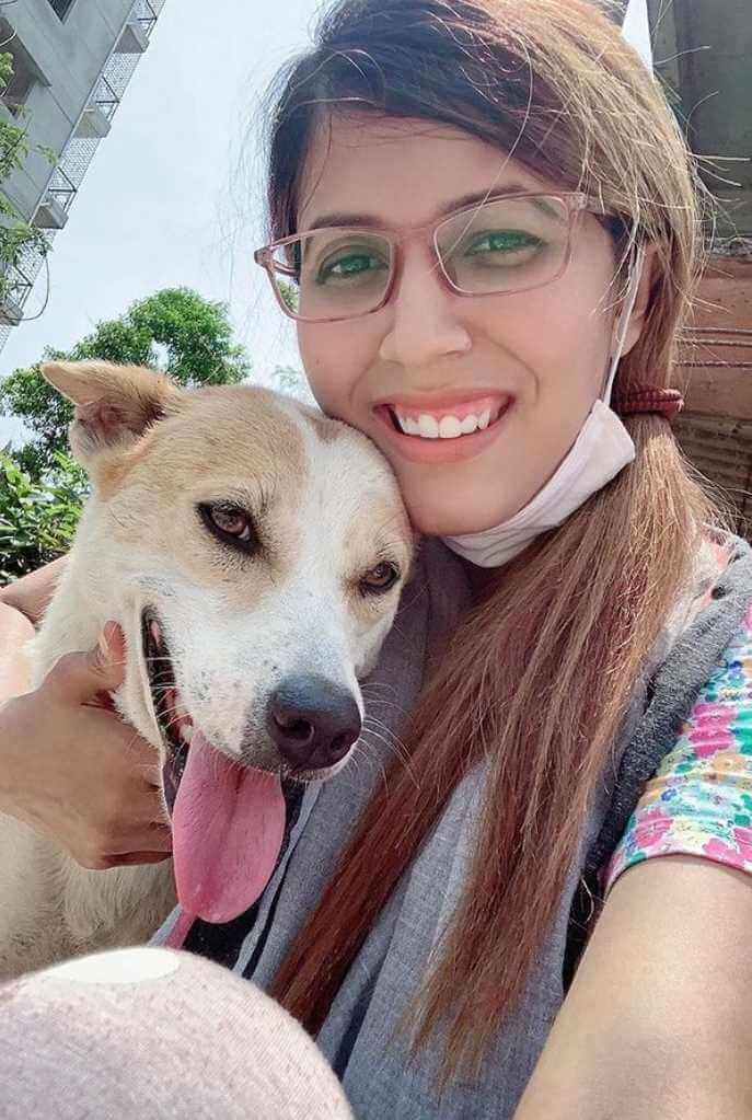 Naila Nayem with Dog Photo