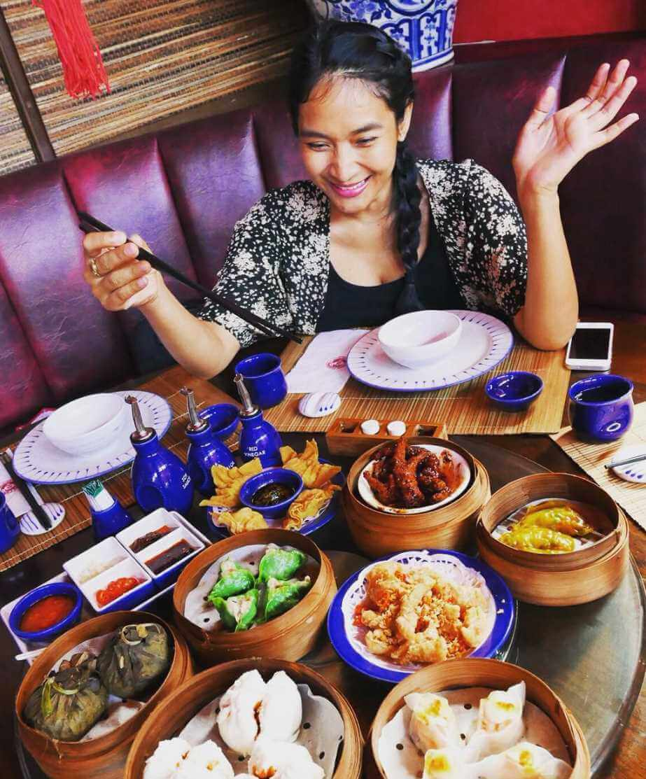 Happy Salma with foods Image