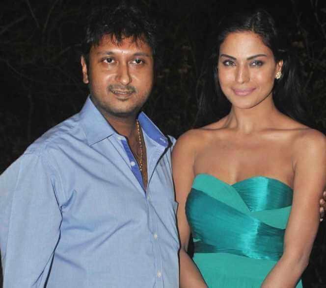 Hemant Madhukar with Veena Malik Image